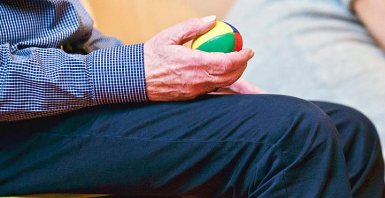 Close up of man holding ball