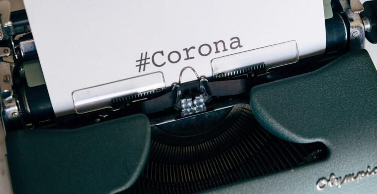 typewriter with corona on page