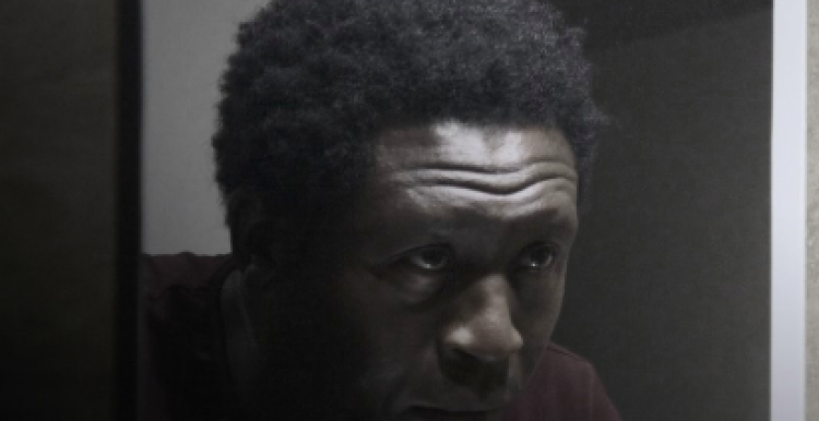 Poster of Orchid film - Black man looking in the mirror