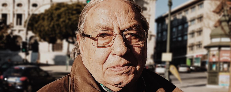 Portrait image of an older man outside