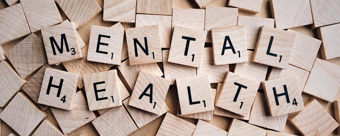 scrabble pieces spelling out mental health