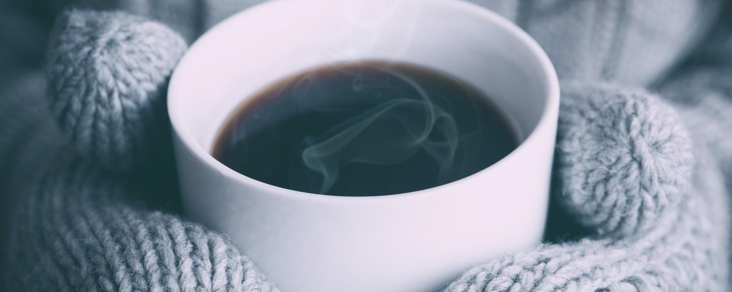 gloves clasping  hot drink