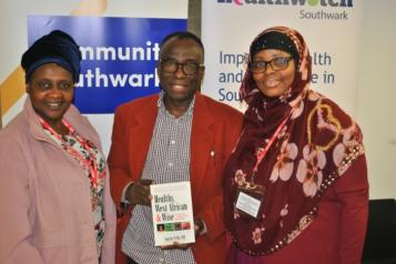 three faith group leaders in front of community southwark banner
