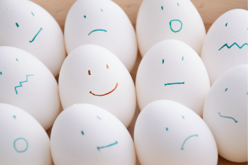 eggs with different expressions drawn up lined up
