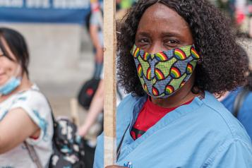 black female nurse with facemask at public demonstration.jpg