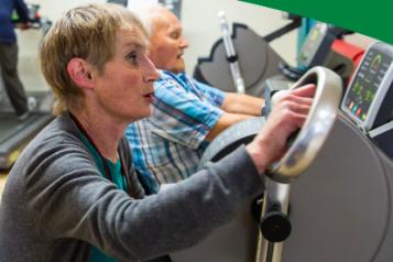 Older people using gym equipment