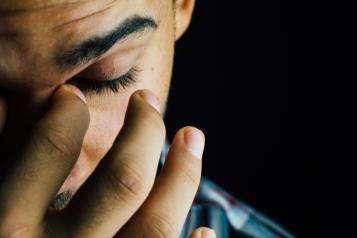 Adult man face sad worried anxious depression