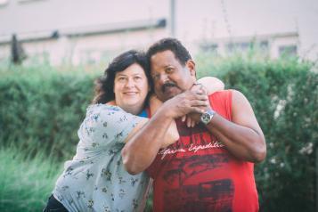 women and latino man couple hugging
