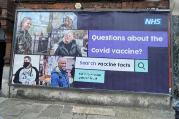 Image of COVID vaccine billboard in Southwark