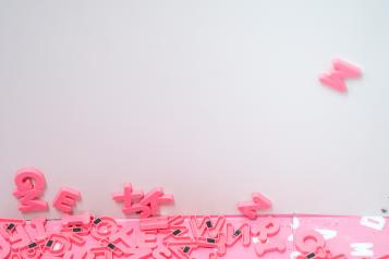 pink letter magnets cascading off wall