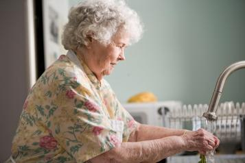 older person washing hands