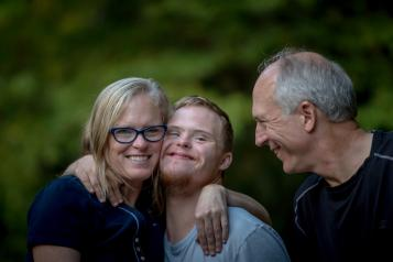 Parents and son with downs syndrome