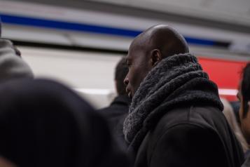 man at tube station