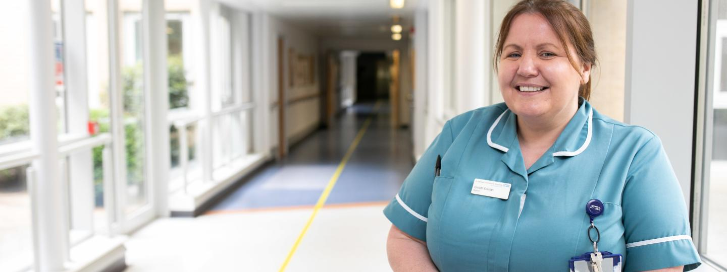 nurse leaning against wall in hospital