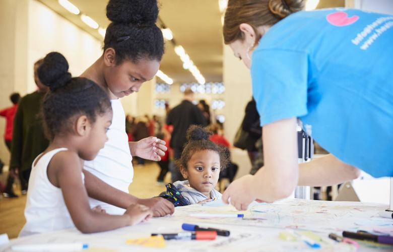 children at healthwatch southwark stall